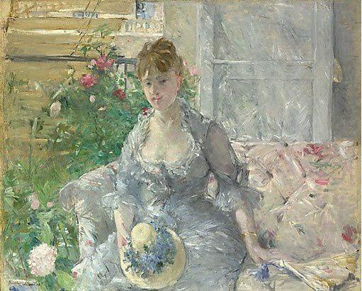 jeune-femme-assise-sur-un-sofa-1879