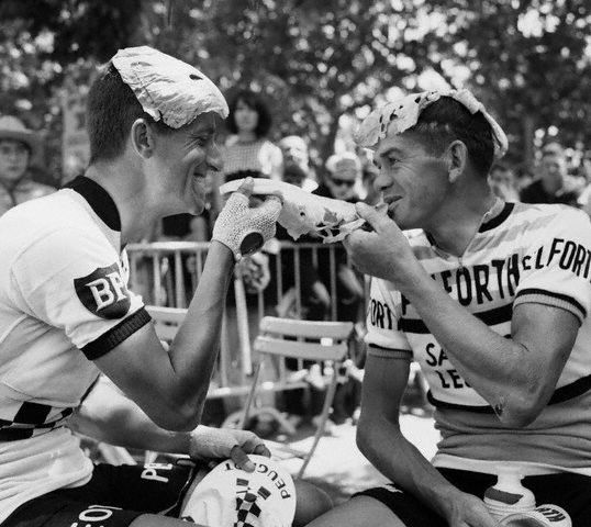 1964--cyclists-wearing-cabbage-leaves-on-heads.jpg