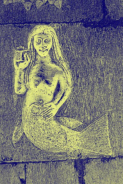 400px-Clonfert_mermaid_crop_-adjusted-_2006-06-21.jpg