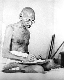 220px-Gandhi_writing_1942.jpg