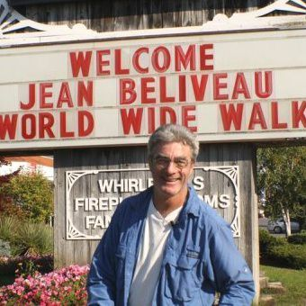 Jean-Beliveau-poses-in-front-of-a-welcome-sign-in-Ontario.jpg