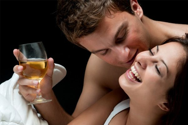 couple-with-wine-in-bed.jpg
