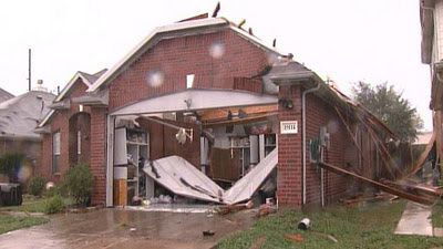 Home-damaged-by-tornado-jpg