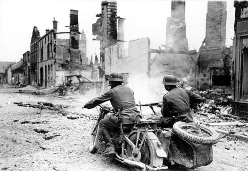 German motorcyclists pass through a destroyed town in Franc</div>         </div>                                   							                							<div class=
