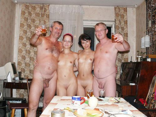 family nude in house