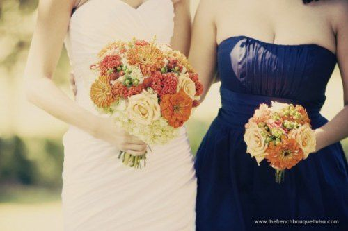 bridal-and-bridesmaid-bouquets-of-orange-red-and-green-peti.jpg