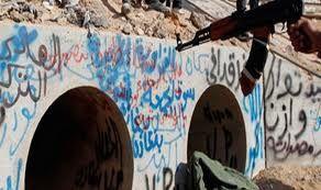 mort Kadhafi tunnel circonstances crime de guerre
