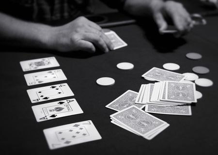 An image of a person playing the poker varient, Texas Hold'em | Source