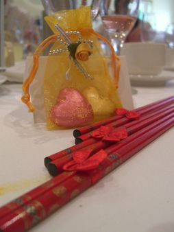 Red chopsticks and chocolate Bomboniere