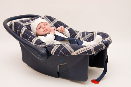 baby in safety seat