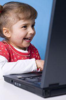 Little girl working on computer