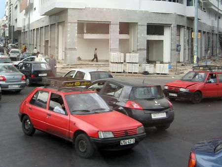 1 Petit taxis among traffic in Casablanca, Morocco. | Source | Author