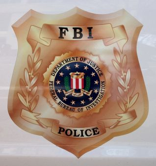 1 Shield of the FBI Police, as seen on the side of an FBI Police vehic