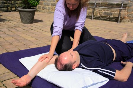 Shoulder stretch as part of a Thai body massage.