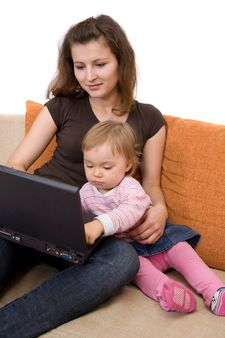 happy family sitting on sofa with laptop