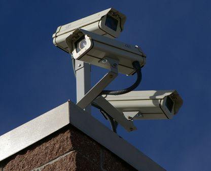 Three surveillance cameras on the corner of a building | Source | Date