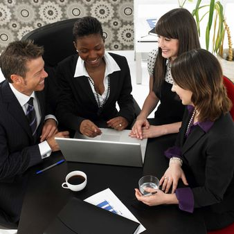 Group of four business people working in an office