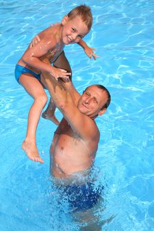 granddad with grandson in the pool