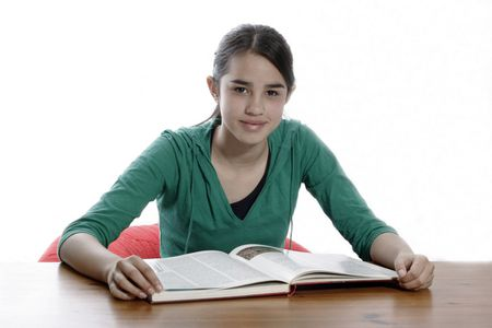 A young woman reading in the library