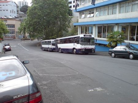Buses waiting in front of the International YHA hostel in Auckland