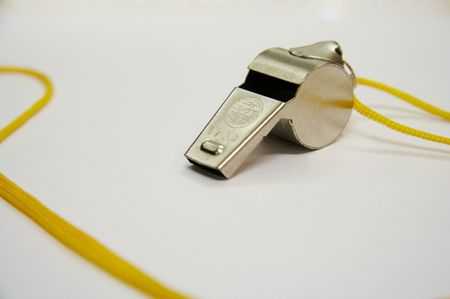 Metal whistle with the yellow cord
