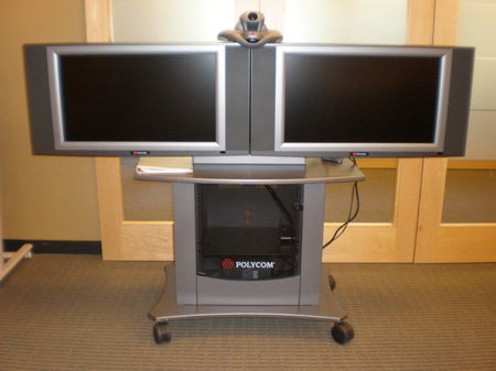 A Polycom VSX 7000 camera used for videoconferencing (top) with 2 vide