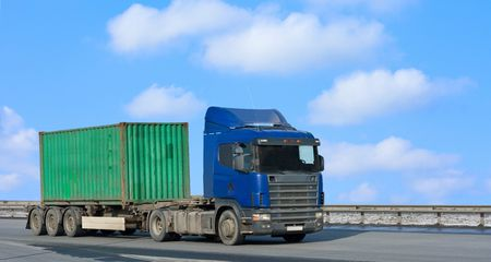 blue truck moves green container