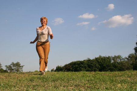 running girl on meadow