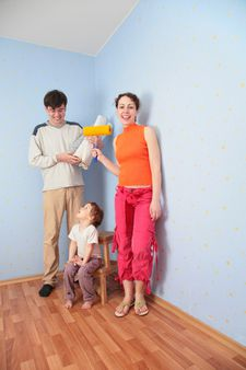 Parents with daughter in room after repair