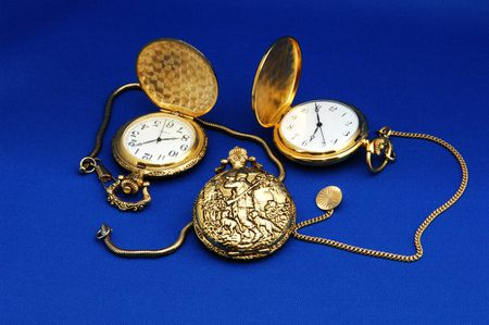 Three antique pocket watches.