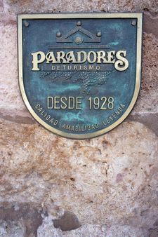 1 Logotype of Paradores in Parador de Lerma main entrance (Province of