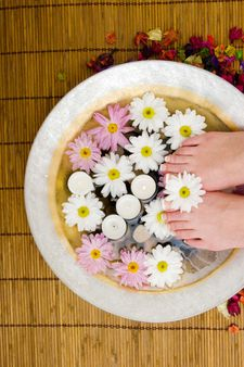 Daisies, candles and pedicured feet