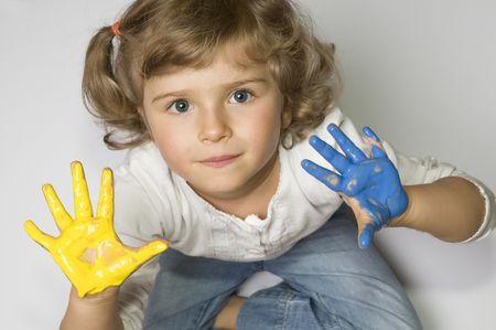 Little girl with colored hands