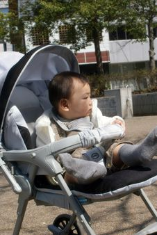 baby in a pushchair