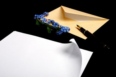 beige envelope & forget-me-not flowers & page