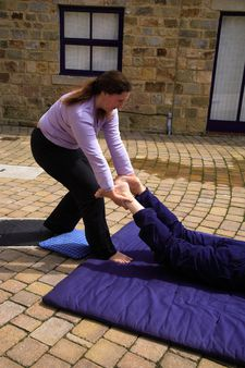 Loosening the pelvis as part of a Thai body massage.
