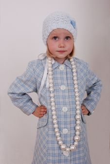 Pretty little girl in nice clothe and beads