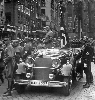 Parade of SA troops past Hitler. Nuremberg | Source Charles Russell C