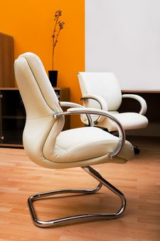 Beige leather armchairs at modern new office