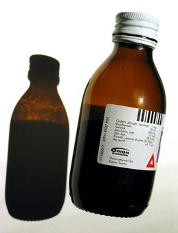 A bottle of Recipect® over-the-counter cough medicine. Pullo reseptit