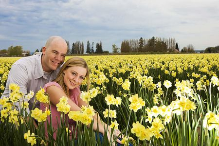 Couple in yellow flower field