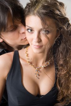 portrait of a beautiful young couple kissing and hugging