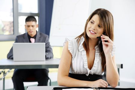close up of woman helpdesk operator and a business man