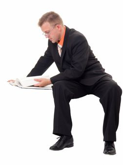 young businessman reads the book on a white background