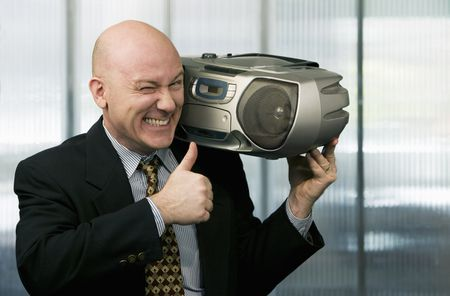 Bald businessman listening to a boom box