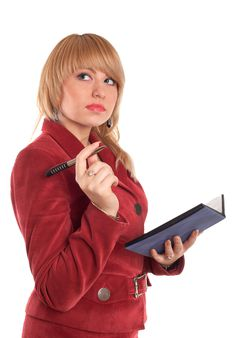 An image of businesswoman in red suit with pen