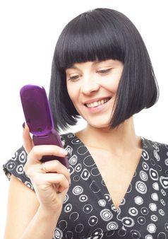 smiling woman with mobile phone close up