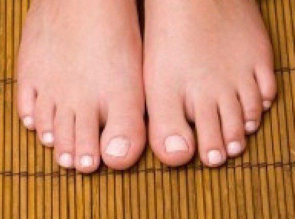 7431993-woman-s-pedicured-feet-on-bamboo-mat.jpg