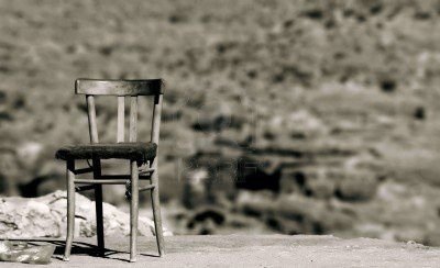 716244-vintage-empty-chair-waiting-for-someone.jpg