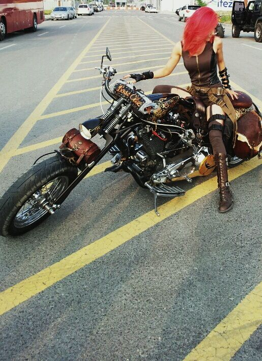 Hyomin riding a motorcycle